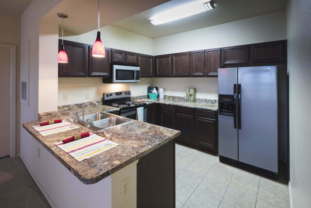 A beautiful modern kitchen with Granite look countertops and stainless appliances